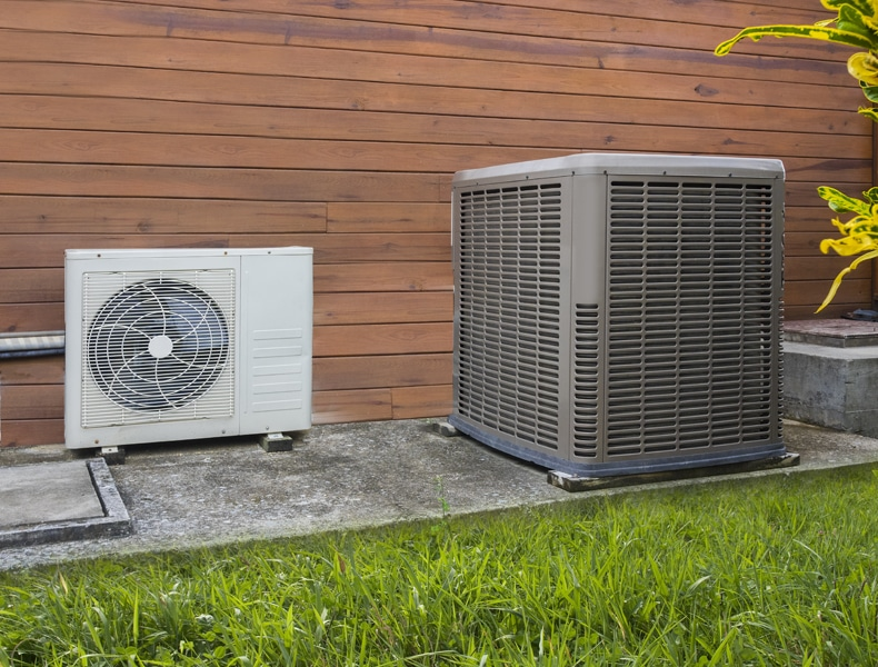An outdoor heat pump by a home representing how you should focus on transitioning it.