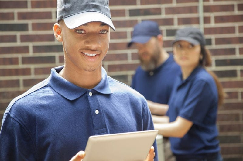 How to Join the HVAC Industry, smiling male technician in blue polo and hat