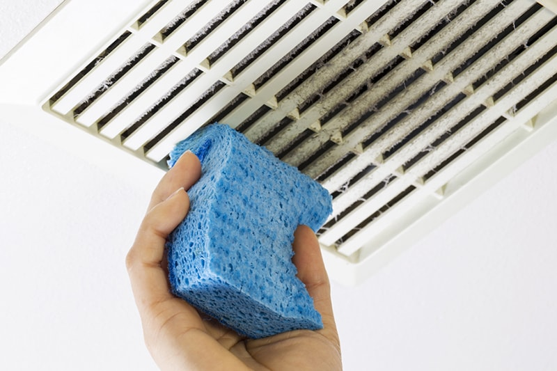 Cleaning Bathroom Fan Vent Cover with Sponge, why is air duct cleaning important