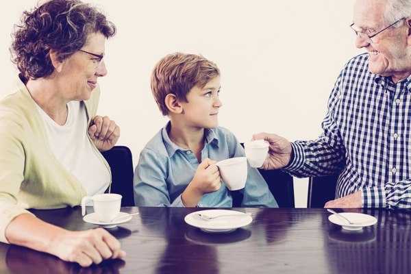Closeup of little boy and his grandparents drinking hot chocolate or tea. Grandfather and child are clinking cups. Isolated view on white background., why is my furnace filter soggy, why is my furnace filter wet